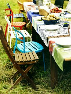 At Midsummer parties in Sweden, gardens become the entertaining area, where wild flowers and colorful table settings complement a tasty smörgåsbord.