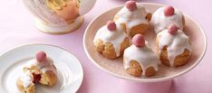 These crisp choux-pastry buns have a frangipane and homemade raspberry jam filling – all topped off with white glacé icing and a truffle cherry. Bakewell Tart, Great British Bake Off, Glace Icing, Homemade Raspberry Jam, Choux Buns, Choux Pastry, British Baking, Thing 1, Serving Plates