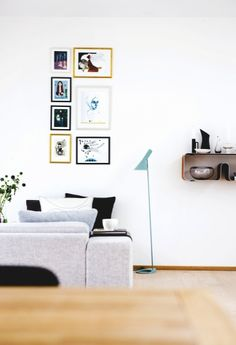 Colour combination of the lamp and paintings in this Scandinavian retreat