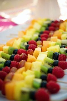 Rainbow fruit skewers I've done this at one of Ashley's parties !! Fun!