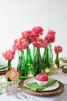 RECEPTION-CENTER PIECES. table decor pink, green. This would be way pretty if you used clear or another type of bottle and/or vase and then use flowers that go with your color scheme. I like how they are by height. - Kim