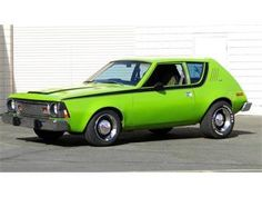 1974 AMC Gremlin. My parents used to have a car like this but blue. My uncle and his wife went on their first date in it.
