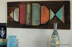 Great DIY Fish Wall Décor made out of wooden pallets.  Great for beach house, lake house or cottage.