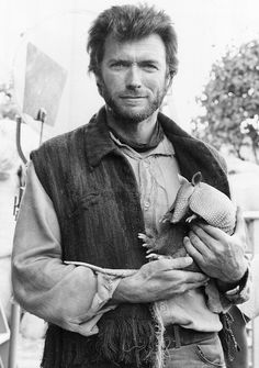 Clint Eastwood holding an armadillo.