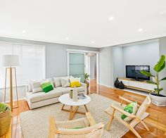 Renovation expert Cherie Barber reveals how she turned an all-brown 1970s-era living room into this light and airy space.