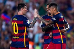 Neymar (R) of FC Barcelona celebrates with his teammate Lionel Messi of FC Barcelona after scoring the opening goal during the Joan Gamper trophy match at Camp Nou on August 5, 2015 in Barcelona, Catalonia.
