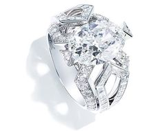 Piaget a 18K white gold ring set with 1 oval-cut diamond (E-VVS2, approx. 4.07 cts), 40 baguette-cut diamonds (approx. 2.00 cts) and 42 brilliant-cut diamonds (approx. 0.93 ct) - Ref.: G34HK400