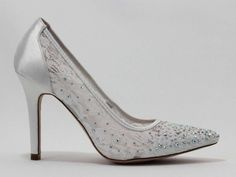 Eleni White Bridal Shoes are a beautiful satin and lace, pointy toe pump. Her lace and AB stones will leave you sparkling at your wedding or any event. Eleni has a satin heel to complete your polished look!  Also available in Nude and Silver