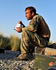 Royal Marine Eats from a Ration Pack in Afghanistan by Defence Images, via Flickr
