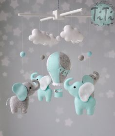Personalized Elephants and balloon baby mobile in custom colors. This item will contains 1 handmade felt hot air balloon handmade felt elephants, 4 handmade felt clouds, 5 handmade wool felt balls and wood mobile in white color. Elephant Mobile, Baby Elephant Nursery, Elephant Elephant, Baby Mobile Felt, Felt Baby, Elephant Balloon, Elephant Applique, Diy Bebe, Baby Zimmer