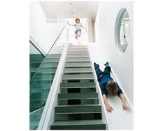 Sometimes stairs can be very boring. That is why some creative people decide to make indoor slides. Indoor slides are very fun and exciting. Blog Architecture, British Architecture, Stair Slide, Stairs With Slide, Indoor Slides, Indoor Slide Stairs, Indoor Climbing, Kids Climbing, Climbing Wall