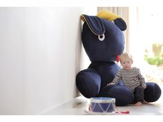 The is a play on the word conine Dutch for rabbit. And who wouldnt want to snuggle in the arms of a giant b. Snuggles, Leather Backpack, Riding Helmets, Fashion Backpack, Baby Kids, Rabbit, Arms, Velvet, Backpacks