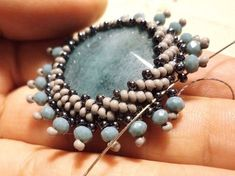 My new video is about making a beaded cabochon, I hope you like it. Yeni videomd… My new video is about making a beaded cabochon, I hope you like it. In my new video, I showed you how to surround the stone with sand beads, I hope you like it. Seed Bead Jewelry, Seed Bead Earrings, Beaded Earrings, Beaded Jewelry, Handmade Jewelry, Beaded Bracelets, Seed Beads, Jewellery, Tutorial Colar