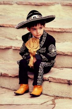 Mexican boy in Charro/Mariachi outfit -- Mariachi is a musical genre that developed out of Central-Western Mexico.