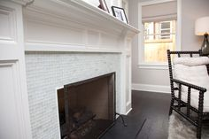 Glass tile mosaic fireplace surround