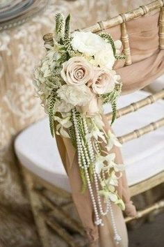 1920's inspired Wedding chair decor. love the pearls. just needs a little lace