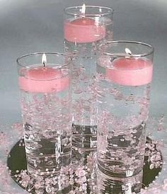 Diy wedding centerpieces pearls floating candles 27 new ideas Non Flower Centerpieces, Candle Wedding Centerpieces, Centerpiece Ideas, Candle Decorations, Graduation Centerpiece, Sweet 16 Centerpieces, Water Beads Centerpiece, Pink Party Decorations, Flowers Vase