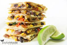 quesadillas stacked with lime Black Bean, Corn, Roasted peppers, caramelized onions & Cheese