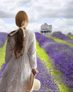 Woman walking in a field of lavender with a house in the background. Lavender Cottage, Lavender Fields, Lavender Color, Lavender Flowers, Color Lila, Jolie Photo, All Things Purple, Provence, Mauve