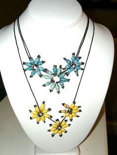 Recycled paper bead flower necklaces. Made by women in Uganda. New design by Jinja Fair Trade. www.jinjafairtrade.org