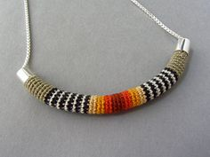 """by Linda Magi - """"small arc necklace"""" in fall colors hand crocheted cotton with hand fabricated argentium silver tips and sterling silver chain included in  Fabulous Fall Finds on Etsy - The Crafted Sparrow"""