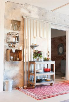 crates on walls and corrugated metal sliding barn door