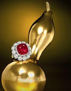 "10.22-Carat Natural Unheated Burmese Mogok ""Pigeon's Blood"" Ruby and Diamond Ring. Estimate HK$18,000,000 - 25,000,000 (US$2,300,000 - 3,200,000)."