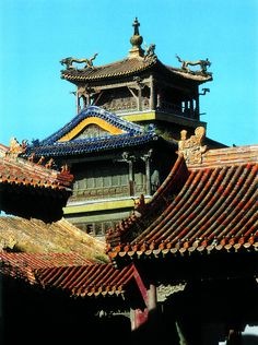 """The Pavilion of the Rain of Flowers. Built during the reign of Qing Emperor Qianlong, it is a three-storied structure with a gilded bronze roof. The pavilion is well-known for its enamel mandala which enshrines a statue of tantric Buddha. From """"Palace Architecture,"""" a volume of the Library of Ancient Chinese Architecture."""