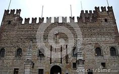 Photo made to Marostica's medieval castle in the province of Vicenza in Veneto Italy. In the image, taken from the castle square you see the battlements of the castle facade in the foreground two columns surmounted by two elements composed in layers of pyramidal shape. The two columns define the bridge that allows the entrance to the castle.