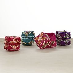 Hand Painted Woven Boxes, Set of 4  (Indonesia)  $15.96     Nestle small gifts inside these pretty Hand Painted Woven Boxes for a dramatic effect! The jewel-toned hues and elaborate Indonesian floral designs painted over woven fibers offer a unique way to store jewelry and other tiny possessions, or display this set of four boxes anywhere in your home for an eclectic splash of color.  Hand Painted Woven Boxes made of lightweight fibers  Set of 4 in pink, purple, red and green  Handcrafted in…