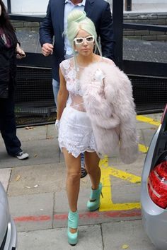 LADY GAGA chose from the Fashion East fold when dressing for a trip to London yesterday, opting for a white, lace spring/summer 2012 look by Simone Rocha - the daughter of designer John Rocha.