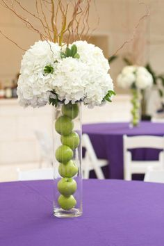 Add non-floral elements to centerpieces for a unique look that will help keep the cost down.