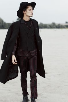 Sharp suits are paired with turtlenecks, Zegna scarfs and the obligatory London rocker's Chelsea boots then topped with a felt fedora by Gladys Tamez Millinery.