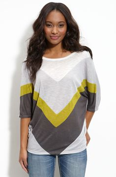 Free shipping and returns on Chloe K Colorblock Chevron Tee (Juniors) at Nordstrom.com. Tonal neutrals with a pop of color accent the front of a cool, slouchy, textured tee with three-quarter dolman sleeves.