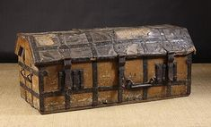 Rare 15th cent. English iron bound elm ark. dome top covered in leather and bound with interwoven iron strapping and two lockplates. very likely a Church chest for securing sacred items.