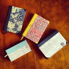 Cover note books in paper of your choice. Add a ribbon.