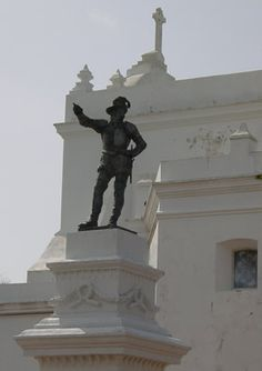 "Although Christopher Columbus claimed the island of Puerto Rico for Spain in 1493, Juan Ponce de Leon (statue below) is seen as the island's founding father because he brought the first colonists there in 1508 while searching for gold and the ""Fountain of Youth."" (Christopher Colombus was actually Italian and real name was ""Cristoforo Colombo"" in Italian and was known as ""Cristobal Colon"" in Spanish. )"