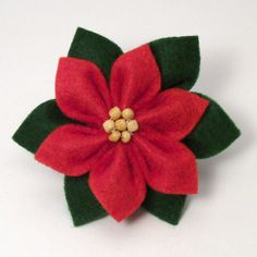 Felt Poinsettia DONATIONWARE craft tutorial : PlanetJune Shop, cute and realistic crochet patterns & Flower Crafts, Diy Flowers, Fabric Flowers, Paper Flowers, Flower Diy, Felt Flowers Patterns, Ribbon Crafts, Poinsettia, Christmas Sewing
