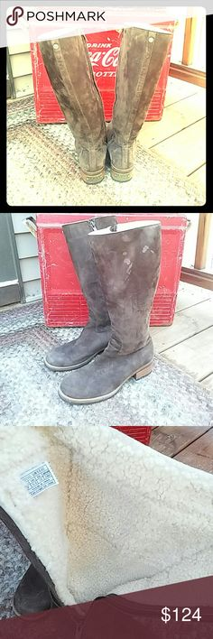 Womans Ugg Rider Boots Excellent condition. Minor wear spots (see picture) sheepskin lined! Adorable for winter! Only worn a few times. Suede exterior chocolate brown. UGG Shoes Winter & Rain Boots