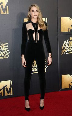 Cara Delevingne from MTV Movie Awards 2016 Red Carpet Arrivals  Before sharing an exclusive sneak peek of her upcoming movie Suicide Squad, the actress wows in her black jumpsuit.