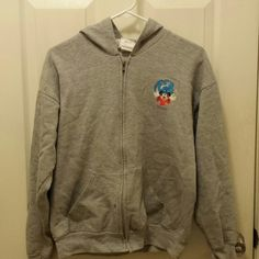 Disneyland Resort jacket with hood This is a Disneyland Resort jacket with hood, pockets and working zipper. It's an XL in kids but will fit a small in ladies. Disneyland Resort Jackets & Coats