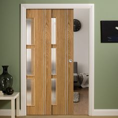 Twin Telescopic Pocket Sierra 3L Oak Veneer Doors - Frosted Glass - Prefinished.    #contemporarydoors #moderninteriordesign  #moderndoors  #hiddendoors