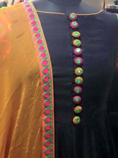 Black anarkali with mango yellow dupatta This is so cute with all the colourful buttons, and I like the dusty orange very much. Salwar Designs, Kurti Neck Designs, Dress Neck Designs, Sleeve Designs, Blouse Designs, Black Anarkali, Anarkali Dress, Kurta Lehenga, Punjabi Dress