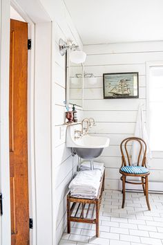 """""""The white subway tile is not unexpected,"""" says Albiani, """"but a rattan lamp we picked up in Mexico gives off amazing light in the corner, and is a nice juxtaposition to the clean bath. Dream Bathrooms, White Bathrooms, Luxury Bathrooms, Master Bathrooms, Cottage Bathrooms, Modern Farmhouse, Best Lobster Roll, Seaside Getaway, Beach Houses For Rent"""