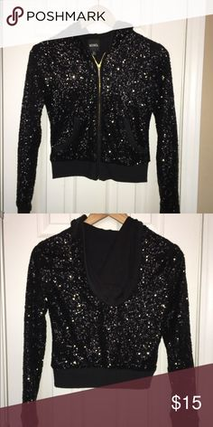 Black XOXO Sequin Hoodie Full-zip placket; long sleeves with ribbed cuffs; angled pockets at the waist; lined; hand wash; 96% RAYON; 4% SPANDEX XOXO Tops Sweatshirts & Hoodies