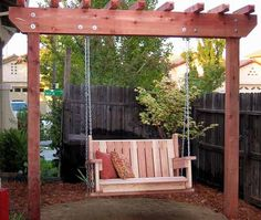 Top bright  garden swings made from wooden pallets. You can use colorful pillows to make it lovely country style.