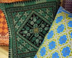 I should really look into embroidered pillows. Just look at these intense colors!