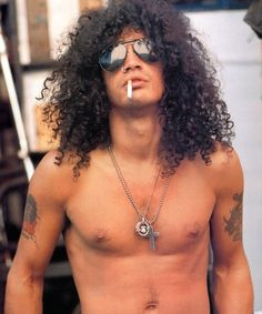 Slash- saw him play at the OC Fair with Fergie a few years ago and he can def rock your socks off with rockin' his guitar.