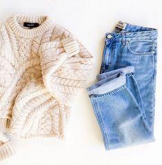 Cream colored sweater and boyfriend jeans for winter capsule wardrobe.