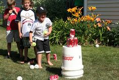 Stack empty coke cans on a stand.  Give the kids 3 balls.  Goal is to knock off all the can.  #Baseball #Party #Games